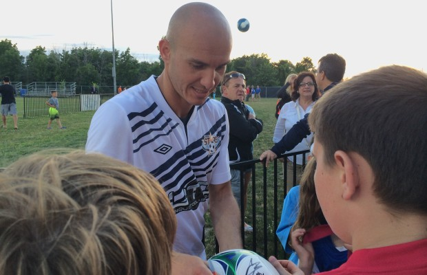 New signing for the Windsor Stars, Danny Dragoi signs autographs after a 2-0 win over Masters FA Saints in Windsor at McHugh Park on July 5, 2014. (Photo by Ricardo Veneza)