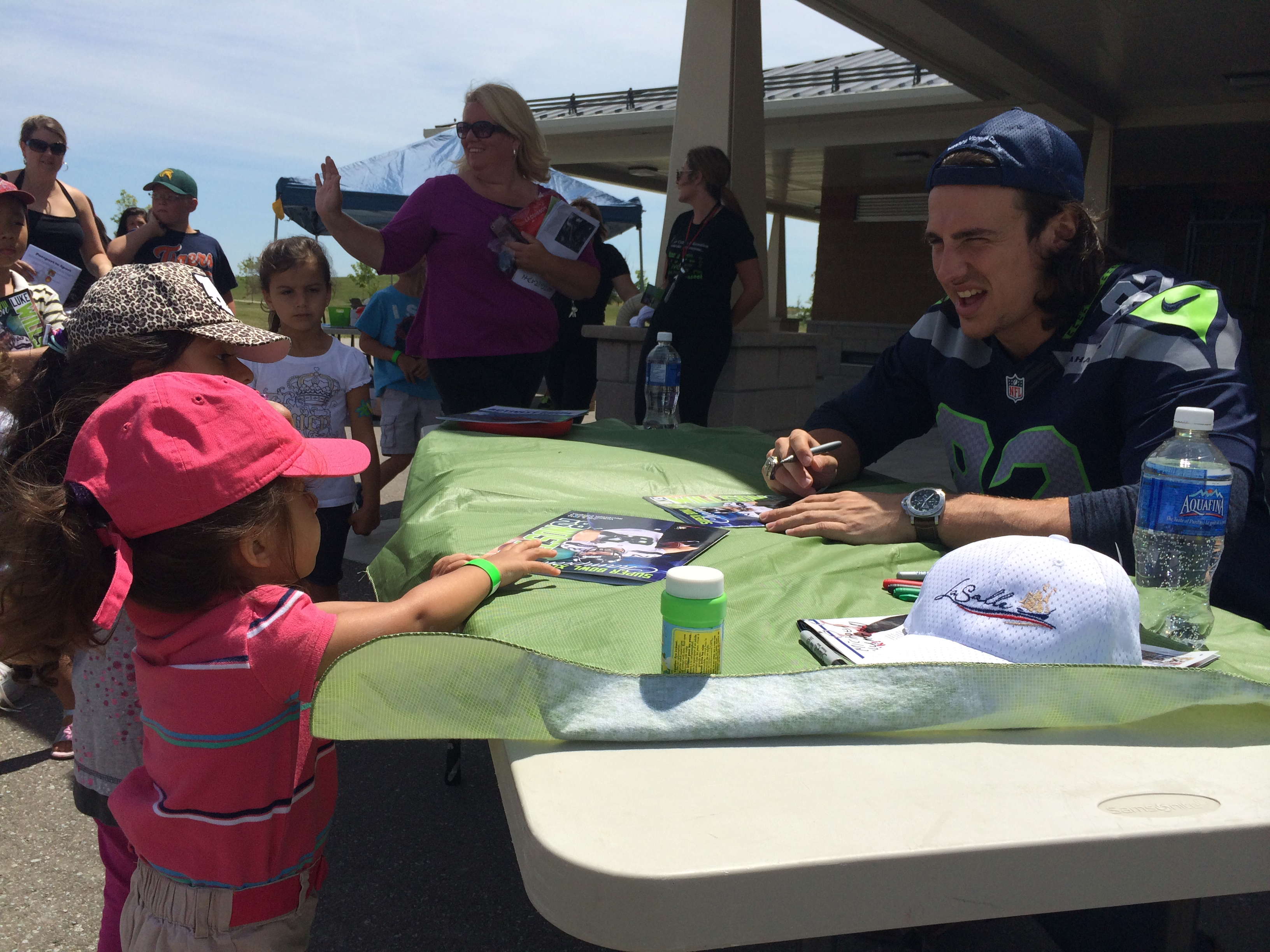 LaSalle native and Super Bowl Champion Luke Willson poses for photos and signs autographs at a community event in his honour held at the Vollmer Recreational Complex on July 5, 2014. (Photo by Ricardo Veneza)
