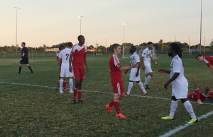 Players for the Windsor Stars and Masters FA Saints shake hands after a 2-0 win in Windsor by the Stars at McHugh Park on July 5, 2014. (Photo by Ricardo Veneza)