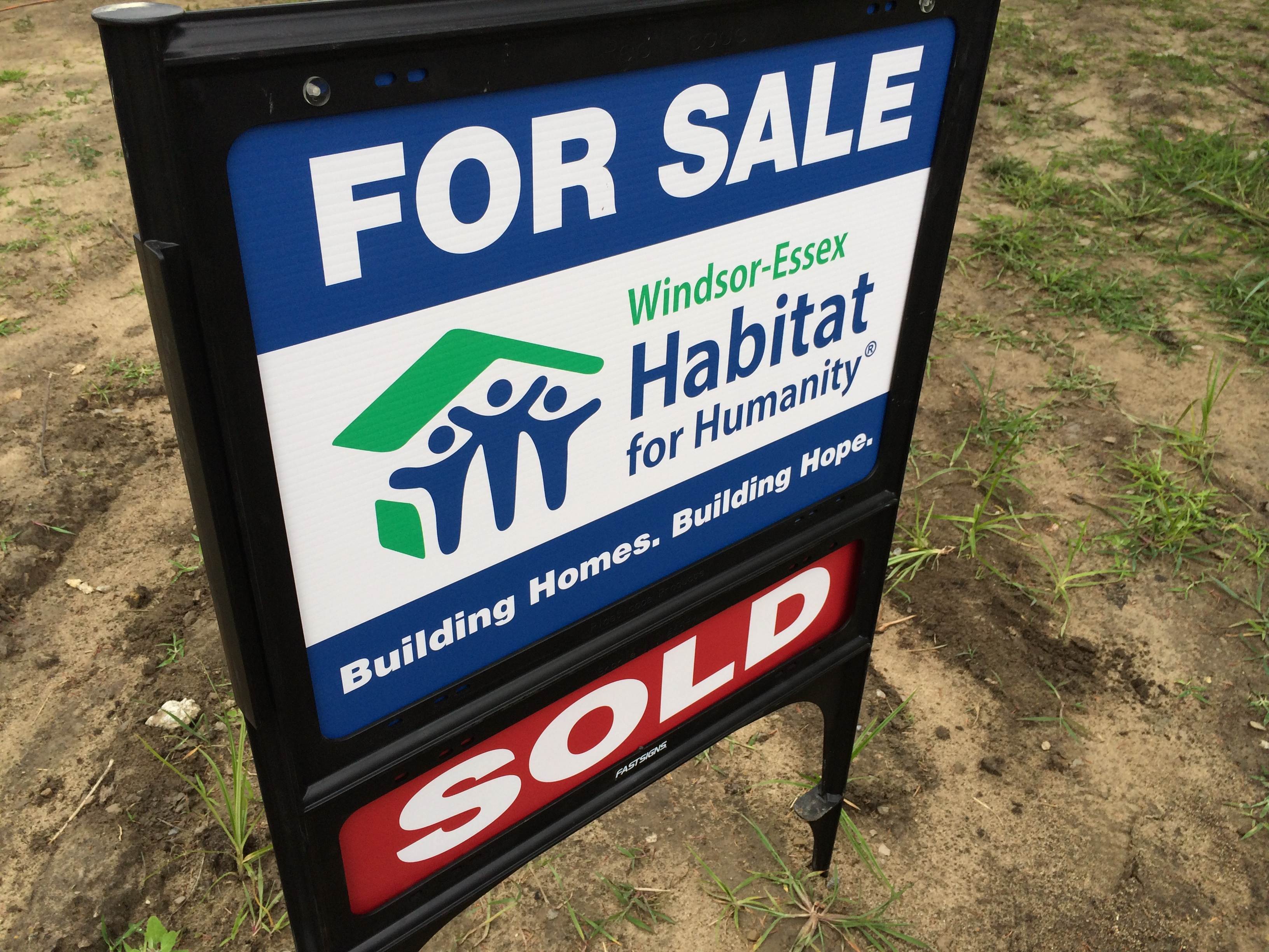 Windsor-Essex Habitat for Humanity sign planted outside a home on Armanda St. in Windsor on July 19, 2014. (Photo by Ricardo Veneza)