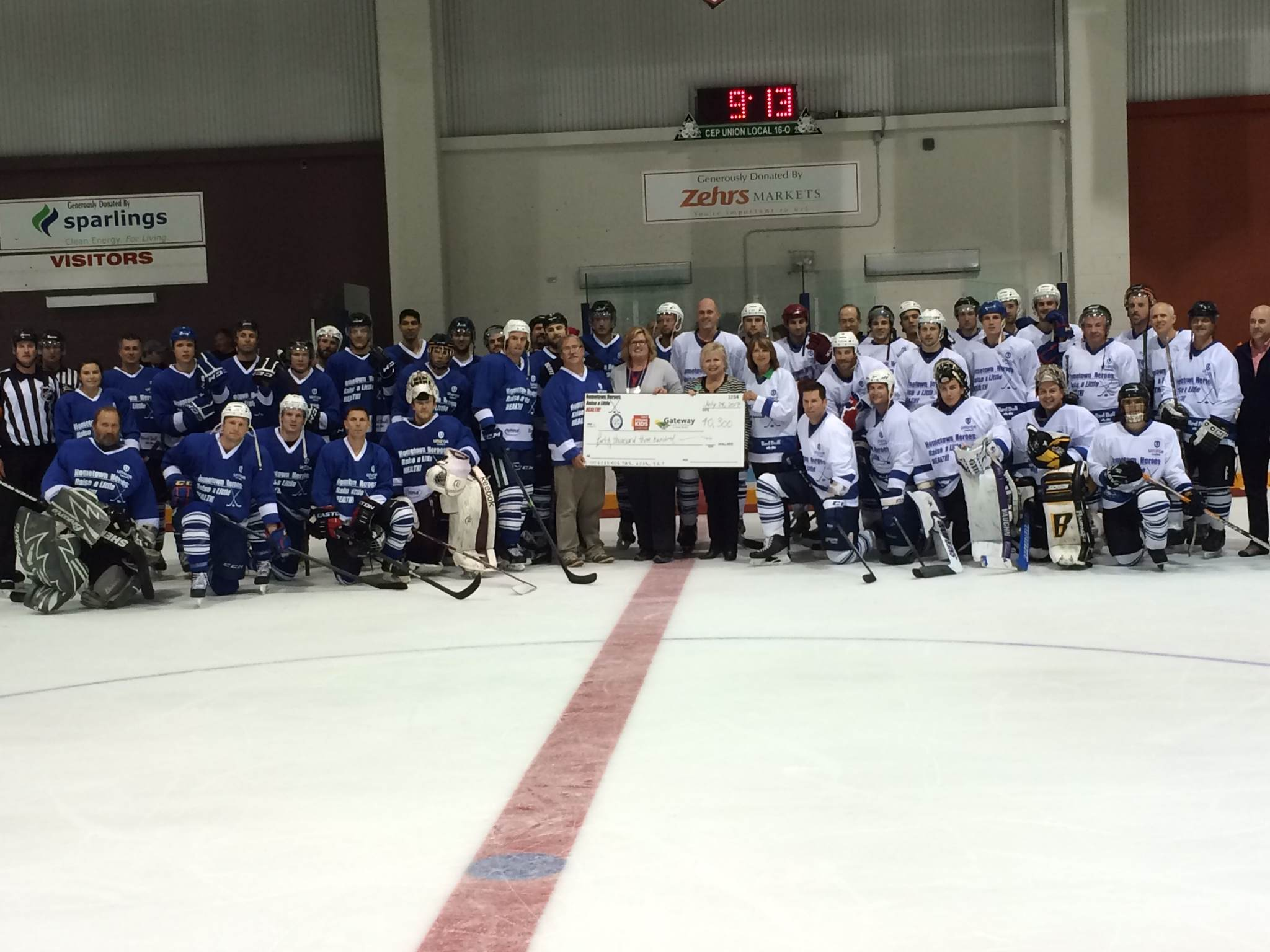 Players in the 'Raise a Little Health' game pose with a $40,300 cheque.