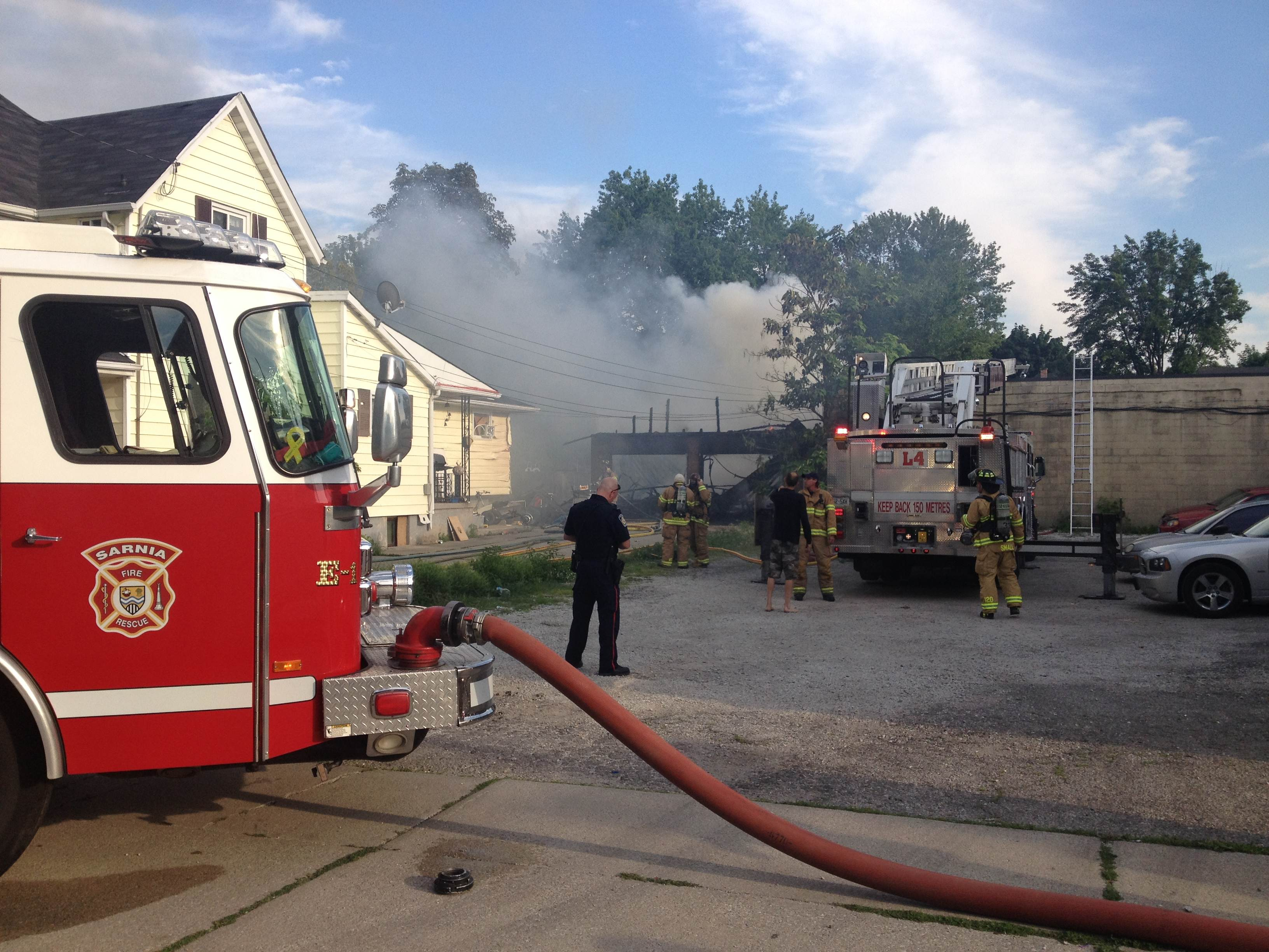 Emergency crews respond to a fire on Davis St. in Sarnia, July 11, 2014. (Photo courtesy of Jon Maillet)