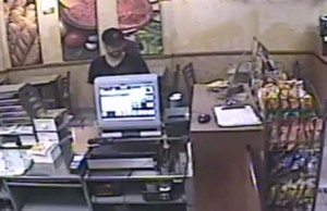 Photo taken from surveillance video of a robbery at the Subway restaurant at 1107 Ouellette Ave. in Windsor.