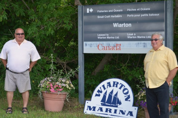 Bruce-Grey-Owen Sound MP Larry Miller [left] and South Bruce Peninsula Mayor John Close announce plans to construct a new breakwall at the marina in Wiarton. Photo by Jordan MacKinnon.