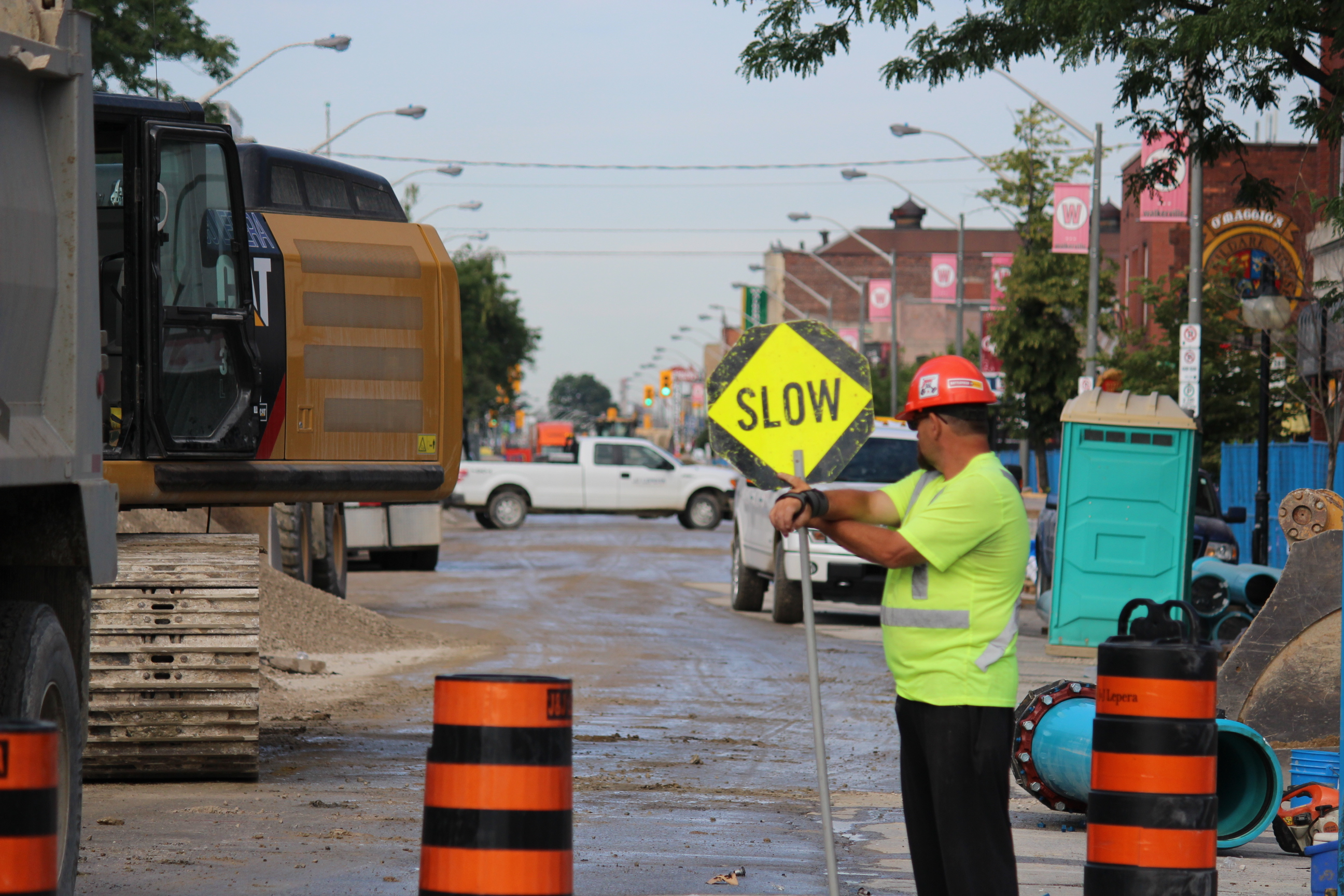 A flagger looks on as construction on Wyandotte St. E. between Devonshire Rd. and Gladstone Ave. continues. (Photo by Adelle Loiselle.)