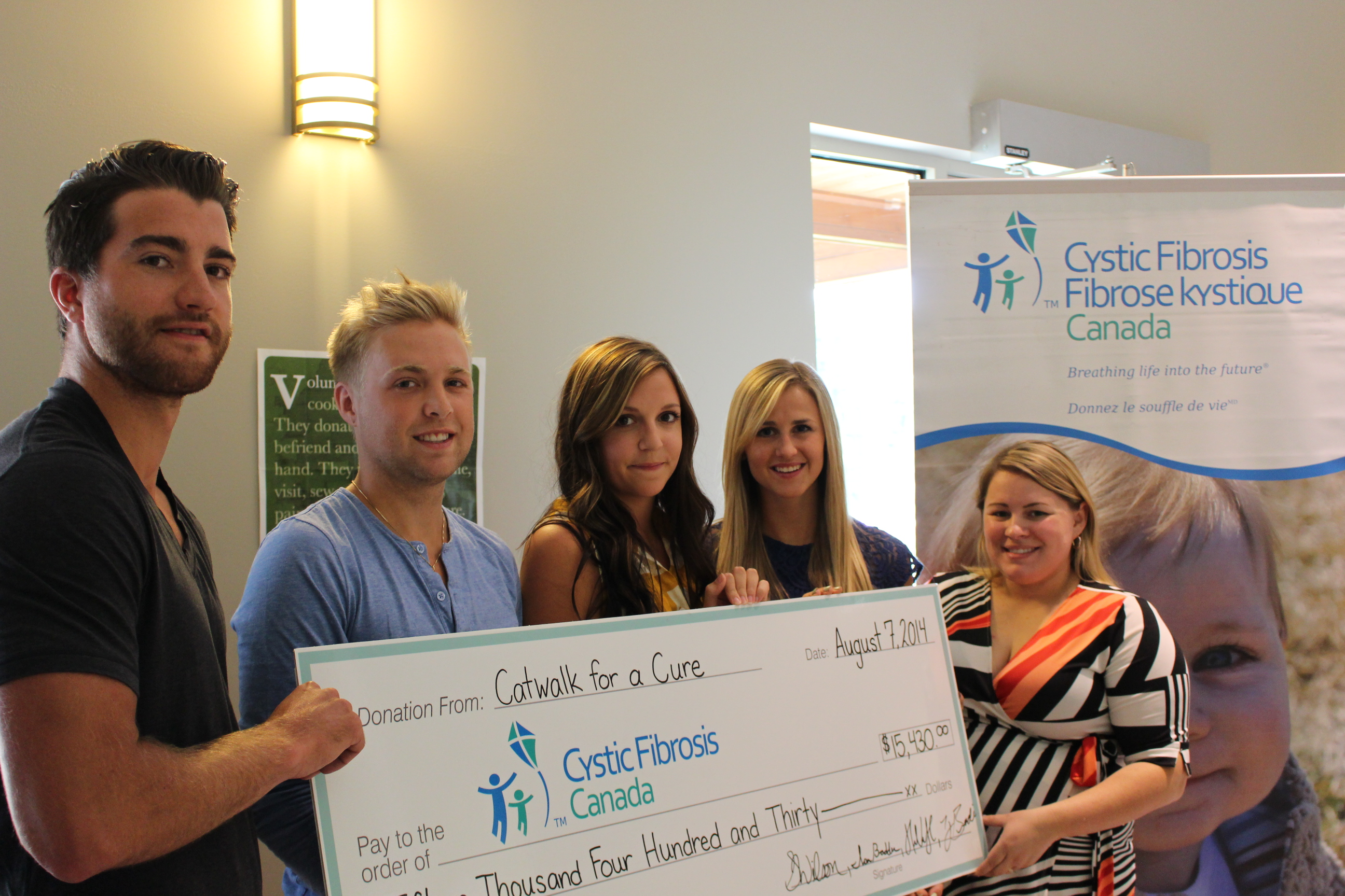 Check presentation for Catwalk For A Cure August 7, 2014. (Photo by Adelle Loiselle.)