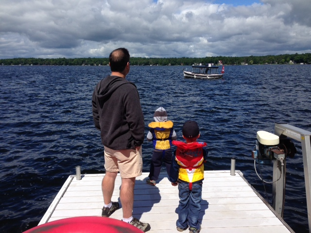 A man and two children dress warmly for a boat ride. Summer 2014 has been cool compared to other years. BlackburnNews.com (Photo by Melanie Irwin)