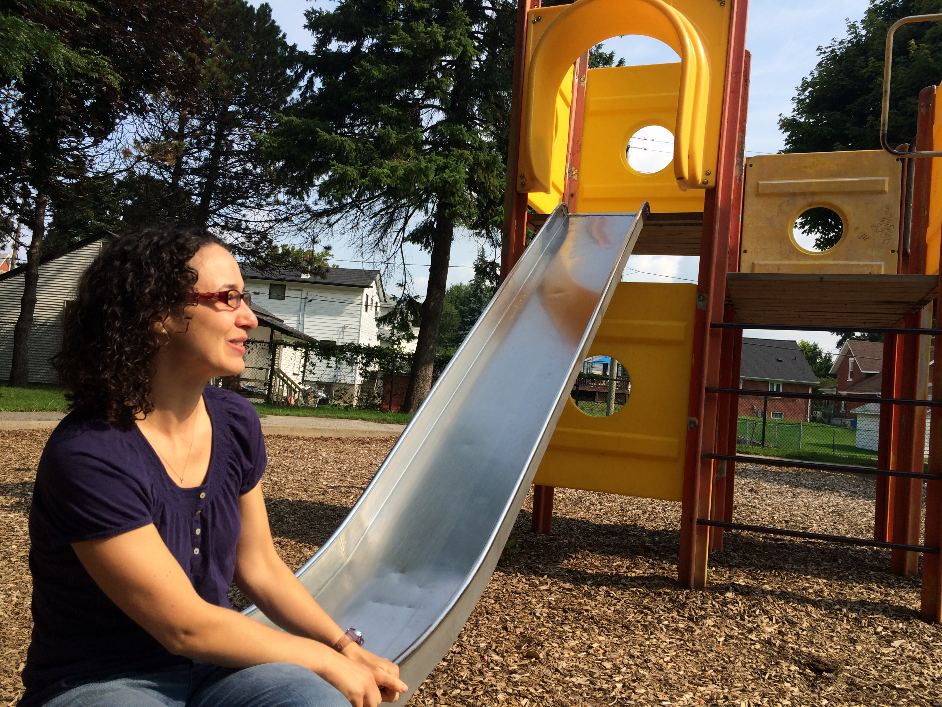 Karen Driedger sits at the end of the old slide at Chestnut Park in Leamington. (Photo by Ricardo Veneza)