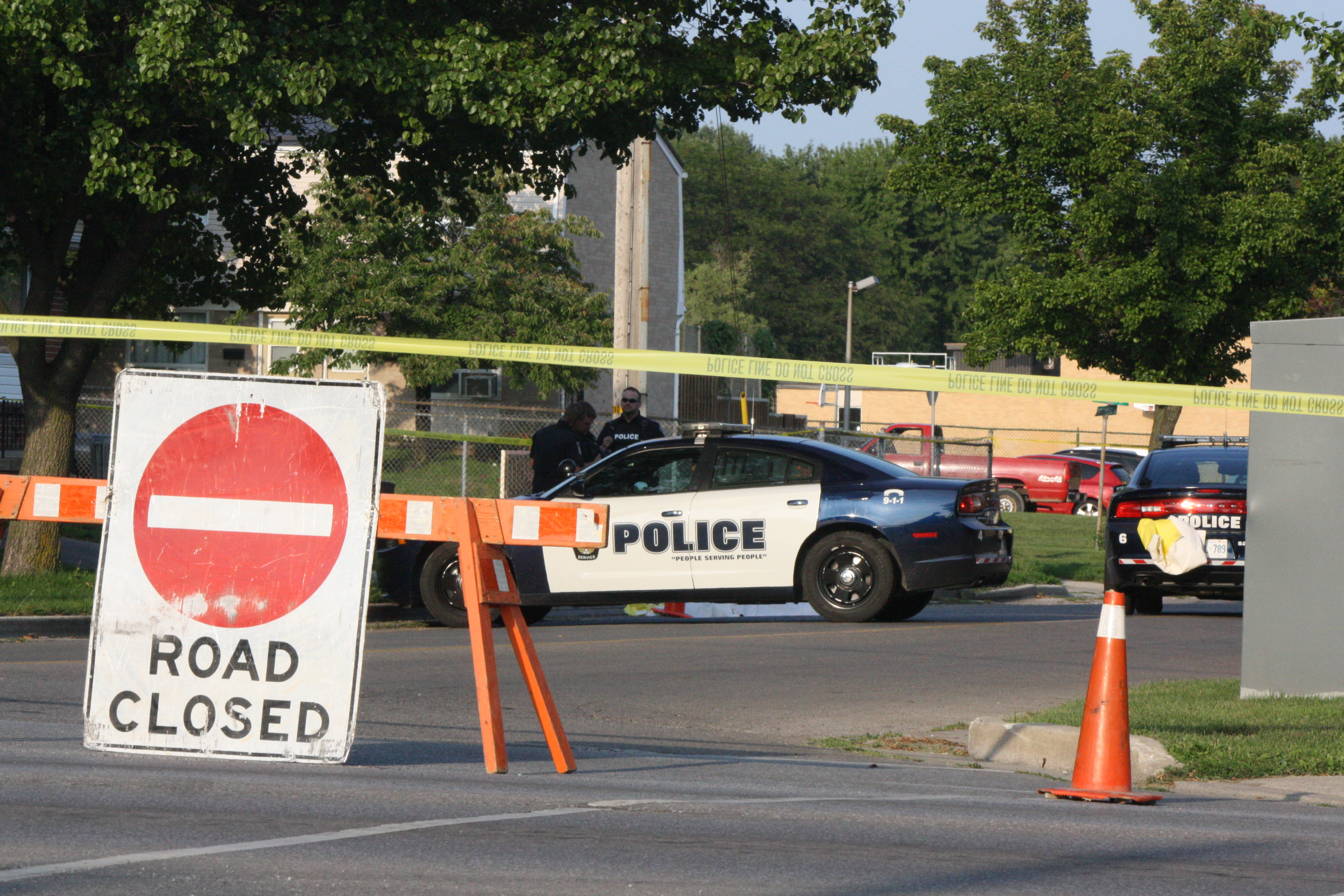 Officers respond to a fatal crash involving a single vehicle and a pedestrian on Maxwell St. in Sarnia, August 10, 2014. (Photo by Dave Dentinger)