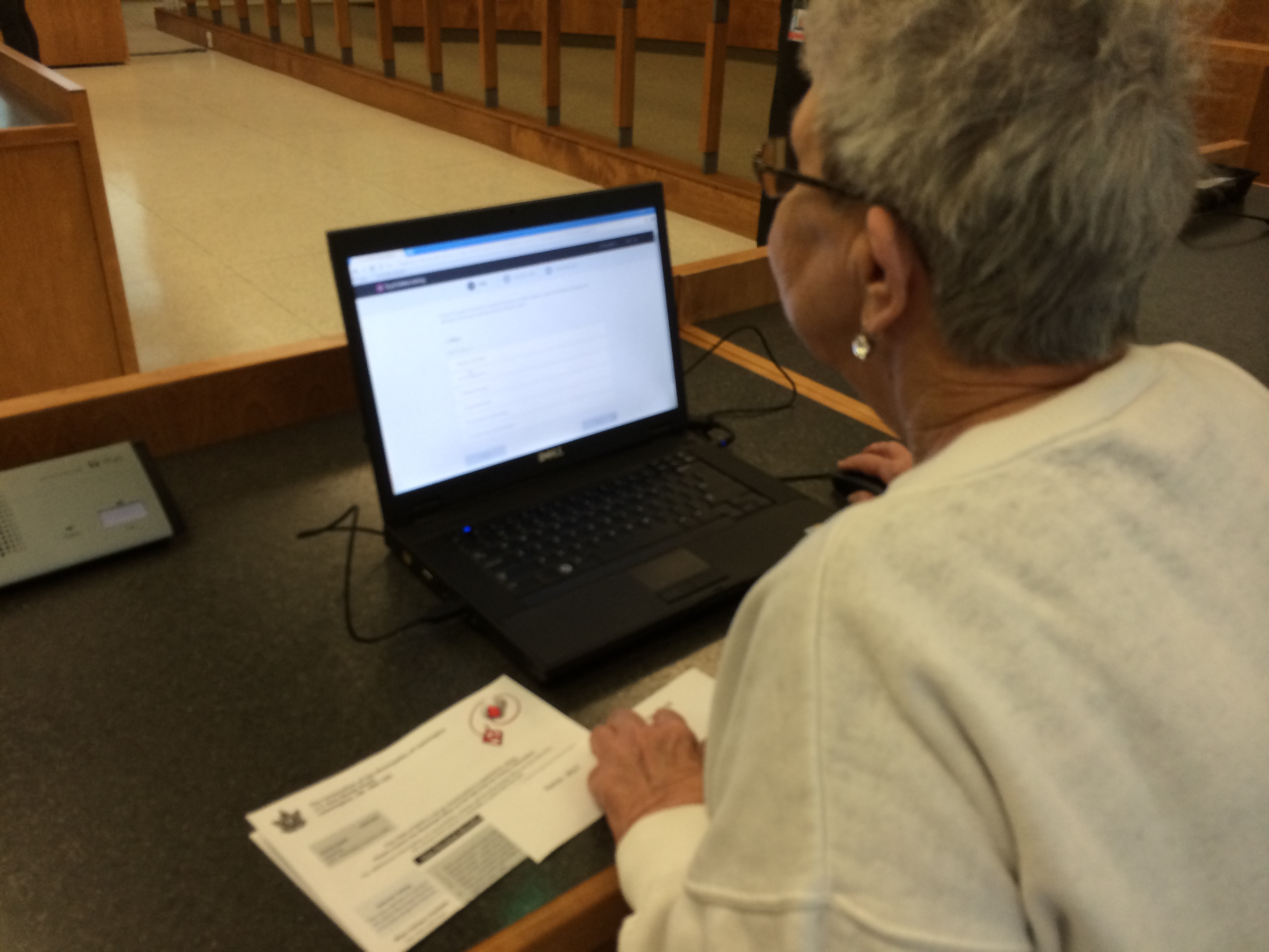 A Leamington resident tries her hand at the new online voting system the municipality will use for the upcoming 2014 election. Photo taken August 27, 2014. (Photo by Ricardo Veneza)