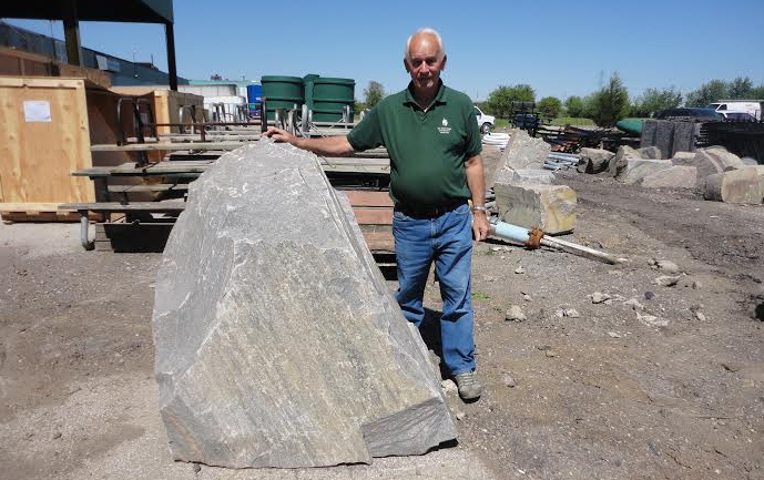 Antonio Perini stands next to the rock that will be placed in Kingston Park. Aug 10 2014 (Photo courtesy of Christina Perini)