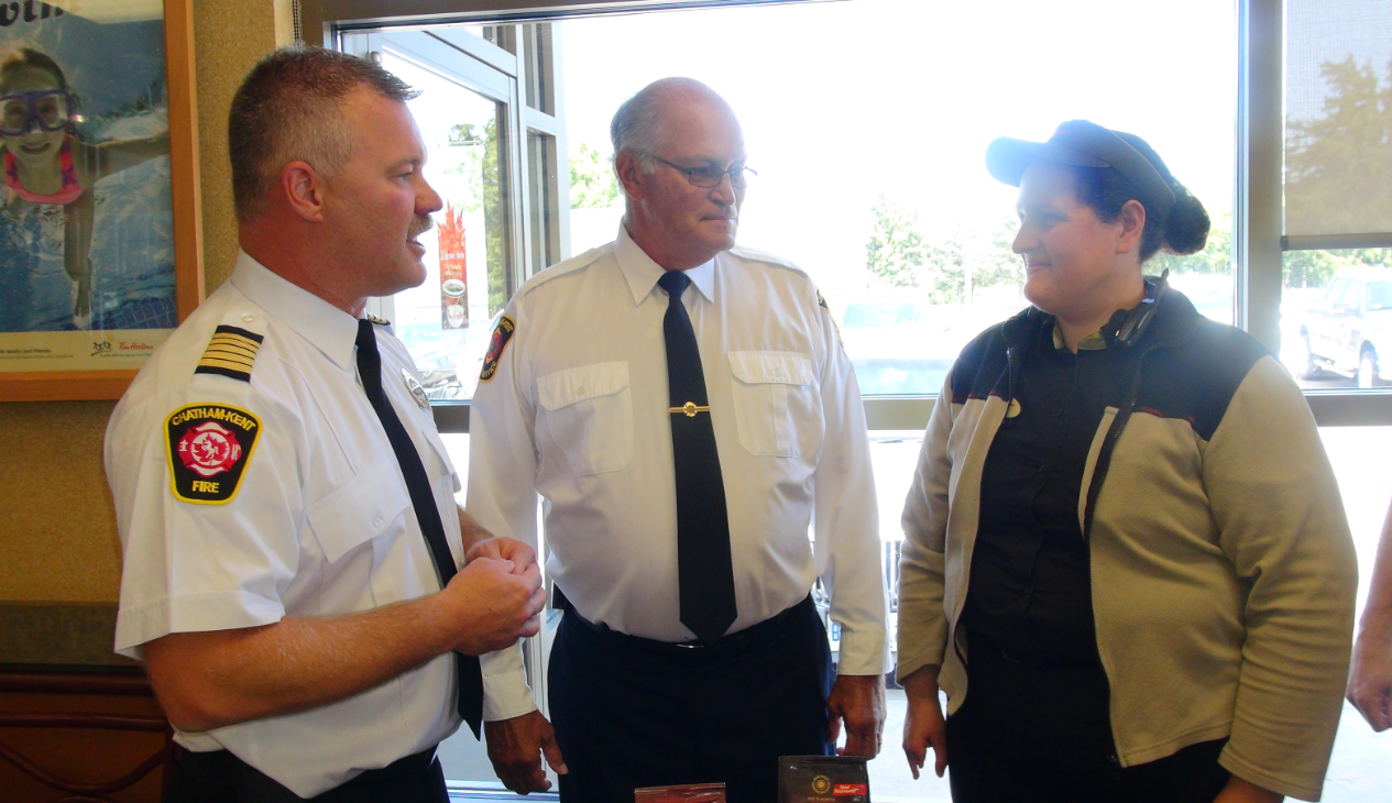 Chatham-Kent Fire Chief Ken Stuebing, Ridgetown Station Deputy Chief Bev Shaw and Tim Hortons Manager Amy Pearce. Aug19 2014 (Photo by Trevor Thompson)