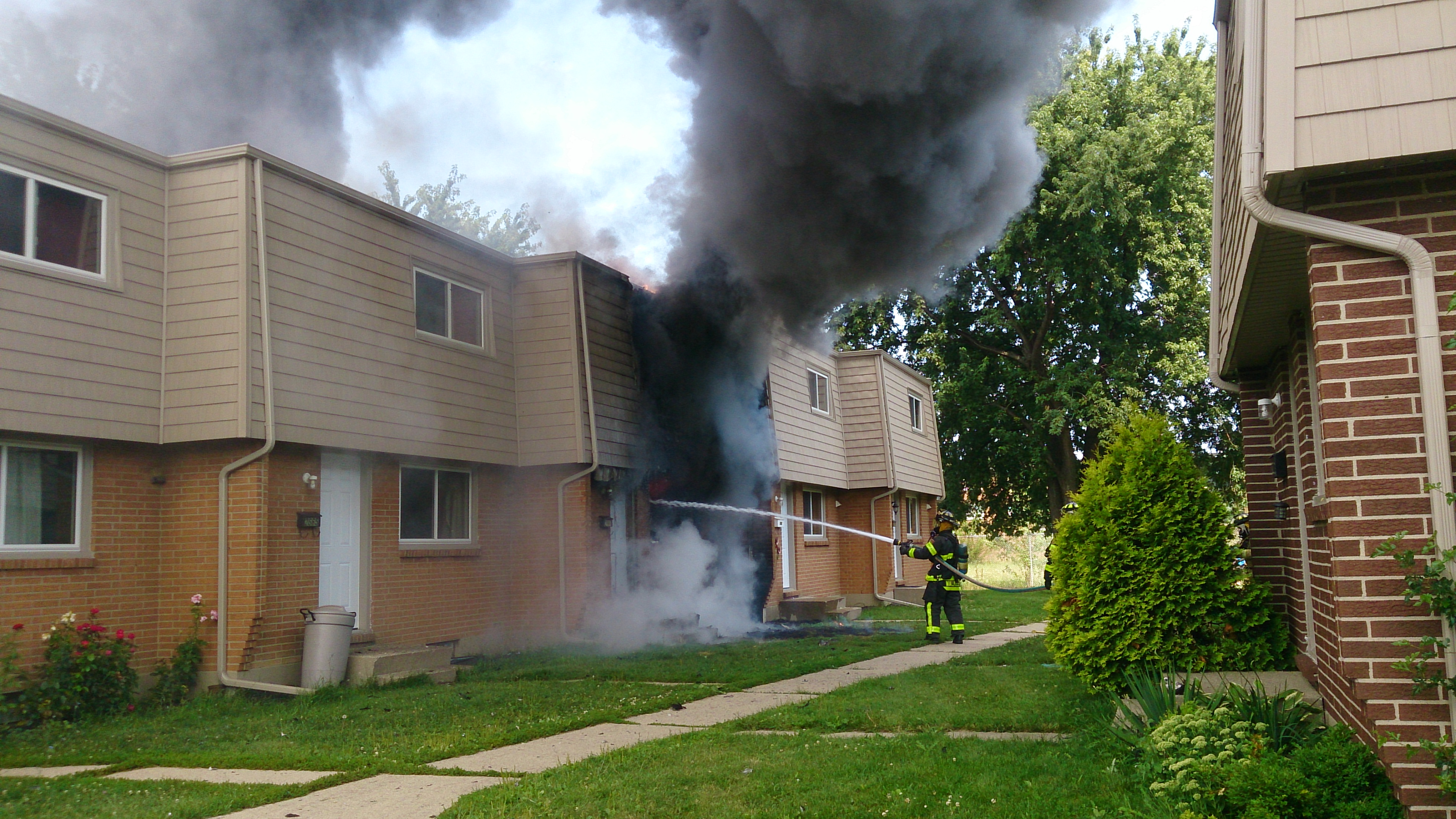 Fire crews battle a blaze in the 2600-block of Scarsdale Rd, in Windsor, August 7, 2014. (Photo courtesy of Frank Krall)