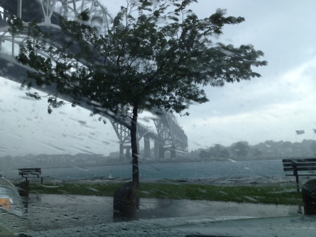 A brief but intense storm whips across the St. Clair River at the Blue Water Bridge Aug 4, 2014 (BlackburnNews.com photo by Dave Dentinger)