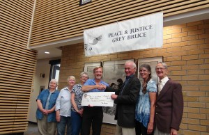 The Society of Energy Professionals' Dick Hibma presents cheque to Peace and Justice Grey Bruce(photo by Kirk Scott)