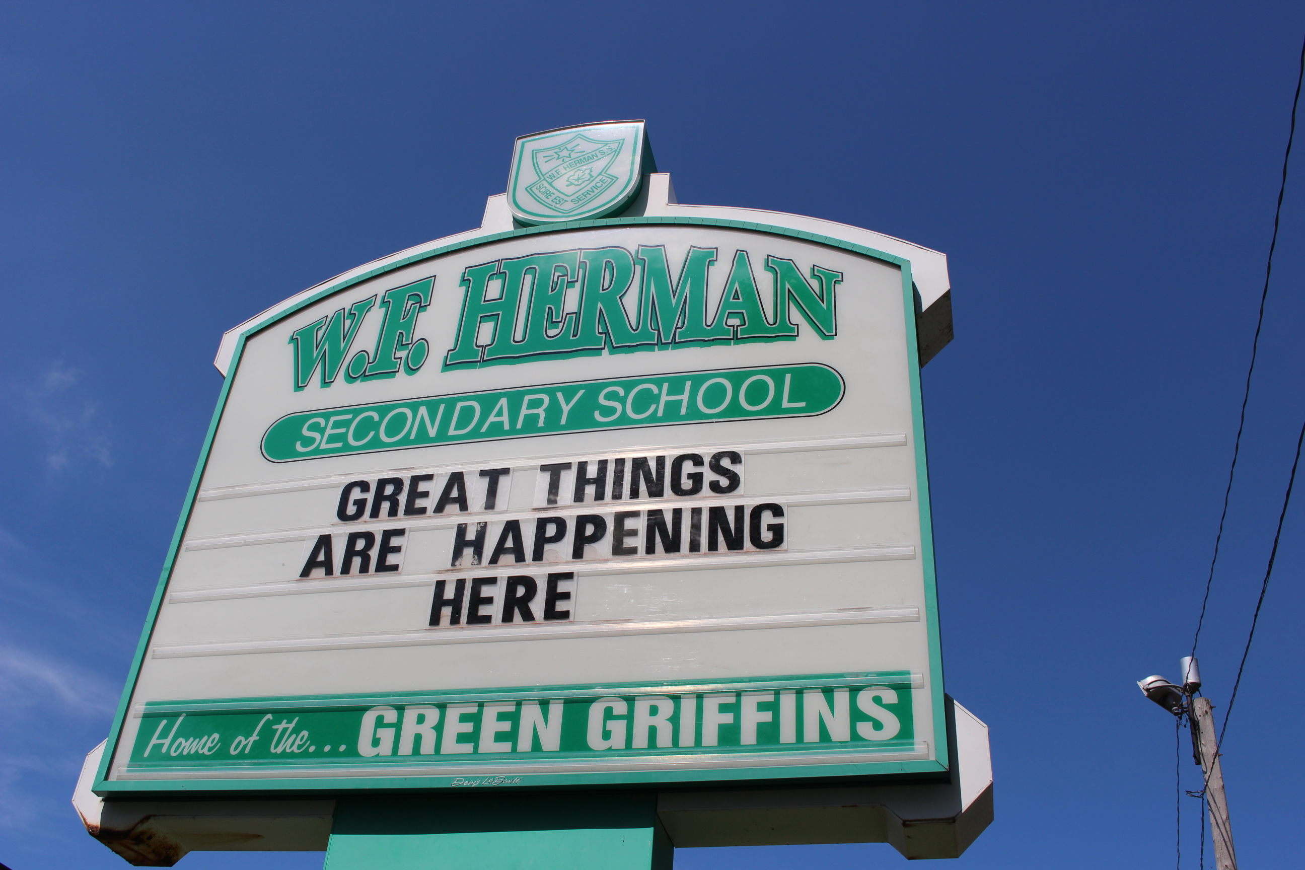 The sign in front of W.F. Herman Secondary School in Windsor. (Photo by Adelle Loiselle.)