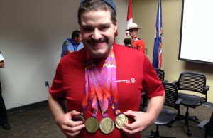 Londoner James Walker shows off his gold and silver medals won in Vancouver at the Special Olympics.