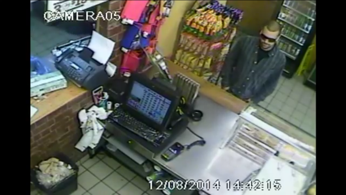 A still from a video released by the Windsor Police Service showing the suspect in three robberies at Subway restaurants in Windsor on August 12, 2014. (Still captured by Ricardo Veneza)
