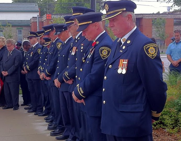 A moment of silence as fire fighters remember those who died in the 9/11 attacks.
