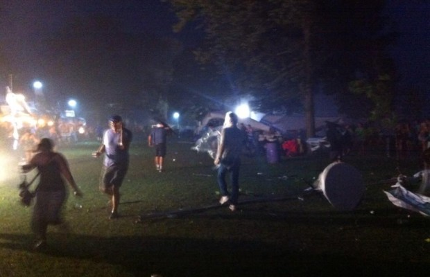 Festival-goers flee the Shores of Erie International Wine Festival during an intense storm, September 5, 2014. (Photo by Kevin Black)