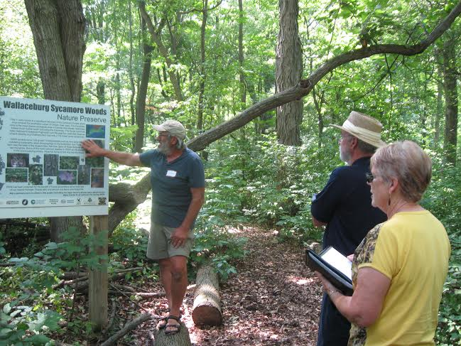 Sydenham Field Naturalist Larry Cornelis tells Community in Bloom judges about Wallaceburg's Sycamore Woods during a visit in July. (Photo courtesy of Sydenham Field Naturalists)