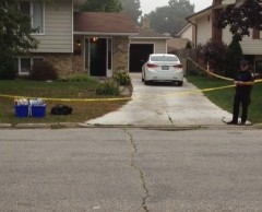 Crime scene tape around a home on Twin Lakes Dr. Sept. 7, 2012