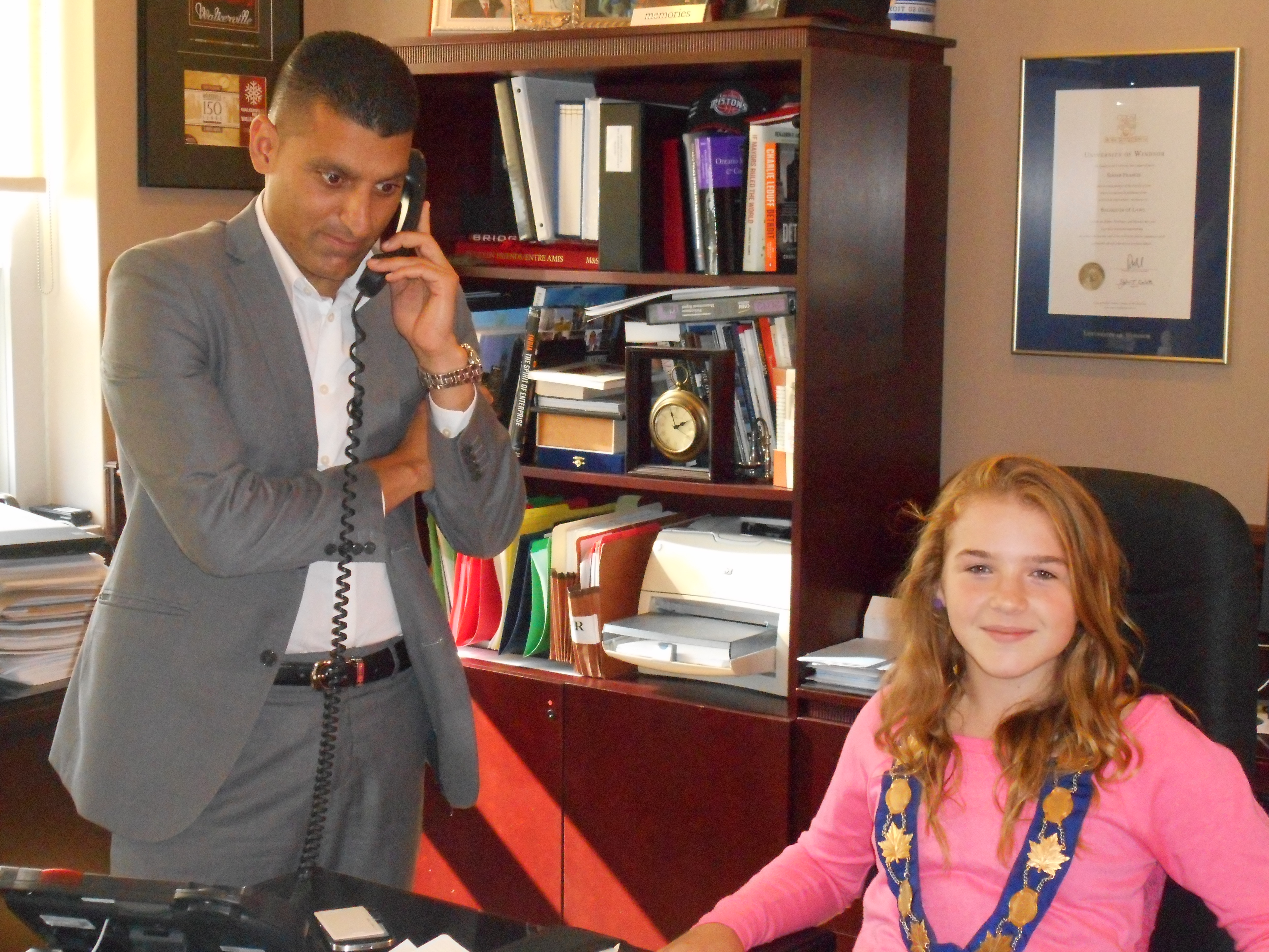 Eddie Francis (right) and Windsor Mayor For A Day Paige Lord (left) courtesy of Big Brothers Big Sisters Windsor Essex executive director John Sutton.