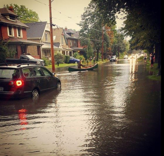 flooded street with person canoeing