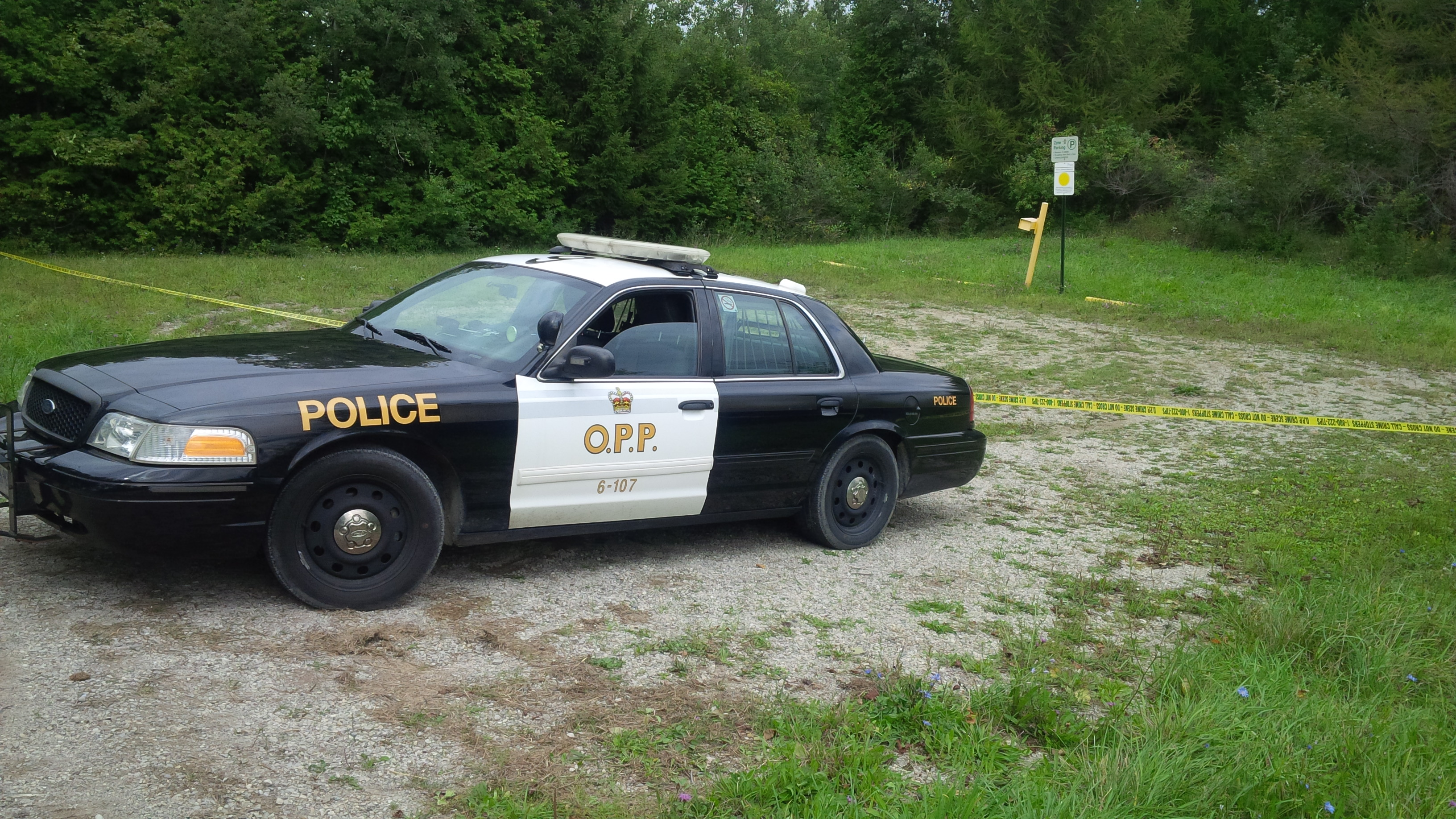 OPP Cruiser sits outside a marked off scene near Clinton.(Photo by Bob Montgomery)
