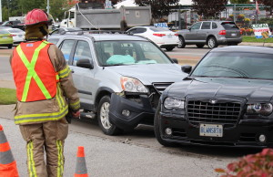 Two cars collided at the intersection of Walker Rd and Division Rd.