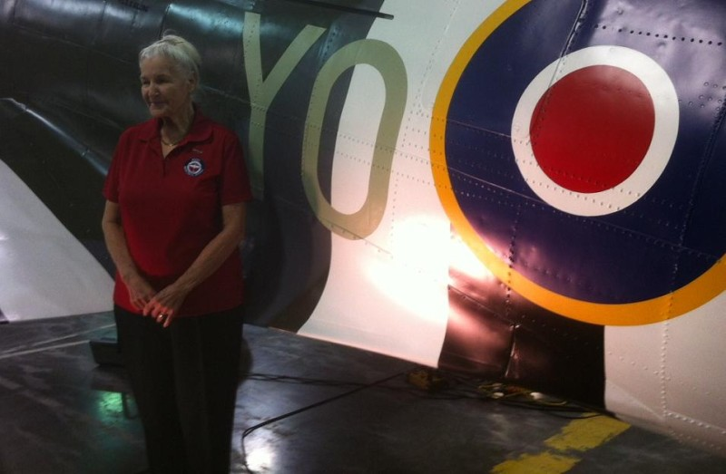 Karen Billings' husband was a Spitfire pilot. This is her and a replica of his plane at Essex Memorial Arena. It will stand permanently in the Town of Essex's Silo District. (photo by Kevin Black)
