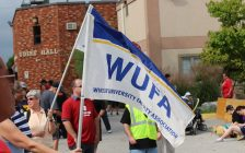 The Windsor University Faculty Association flag at Windsor's 2014 Labour Day Parade. (Photo by Adelle Loiselle.)