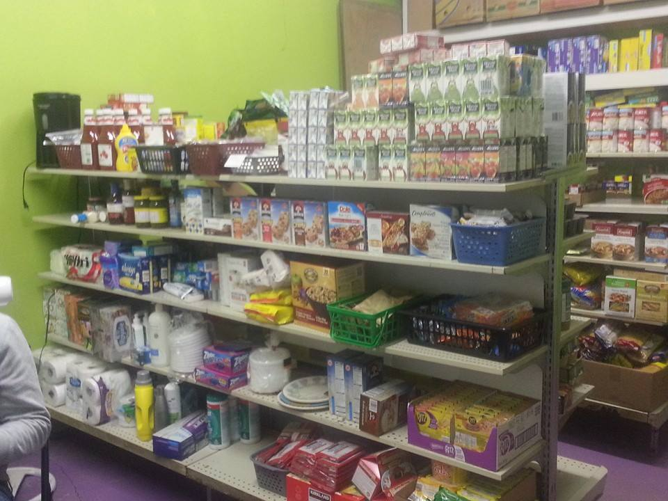 Community donations refill the bare shelves at the Exeter Foodbank