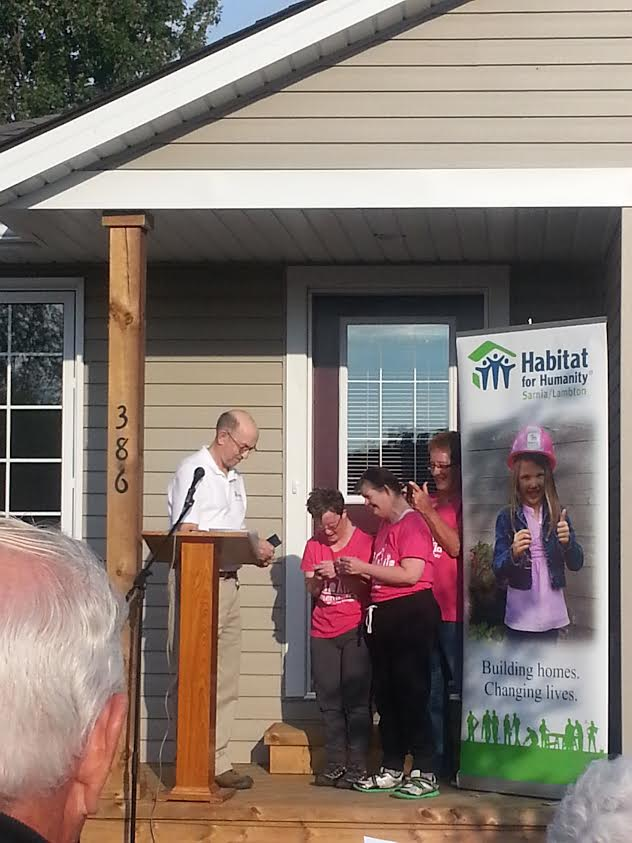 The keys are handed over to the owners of Habitat For Humanity's latest build in Petrolia (Photo by Sarah Woodley )