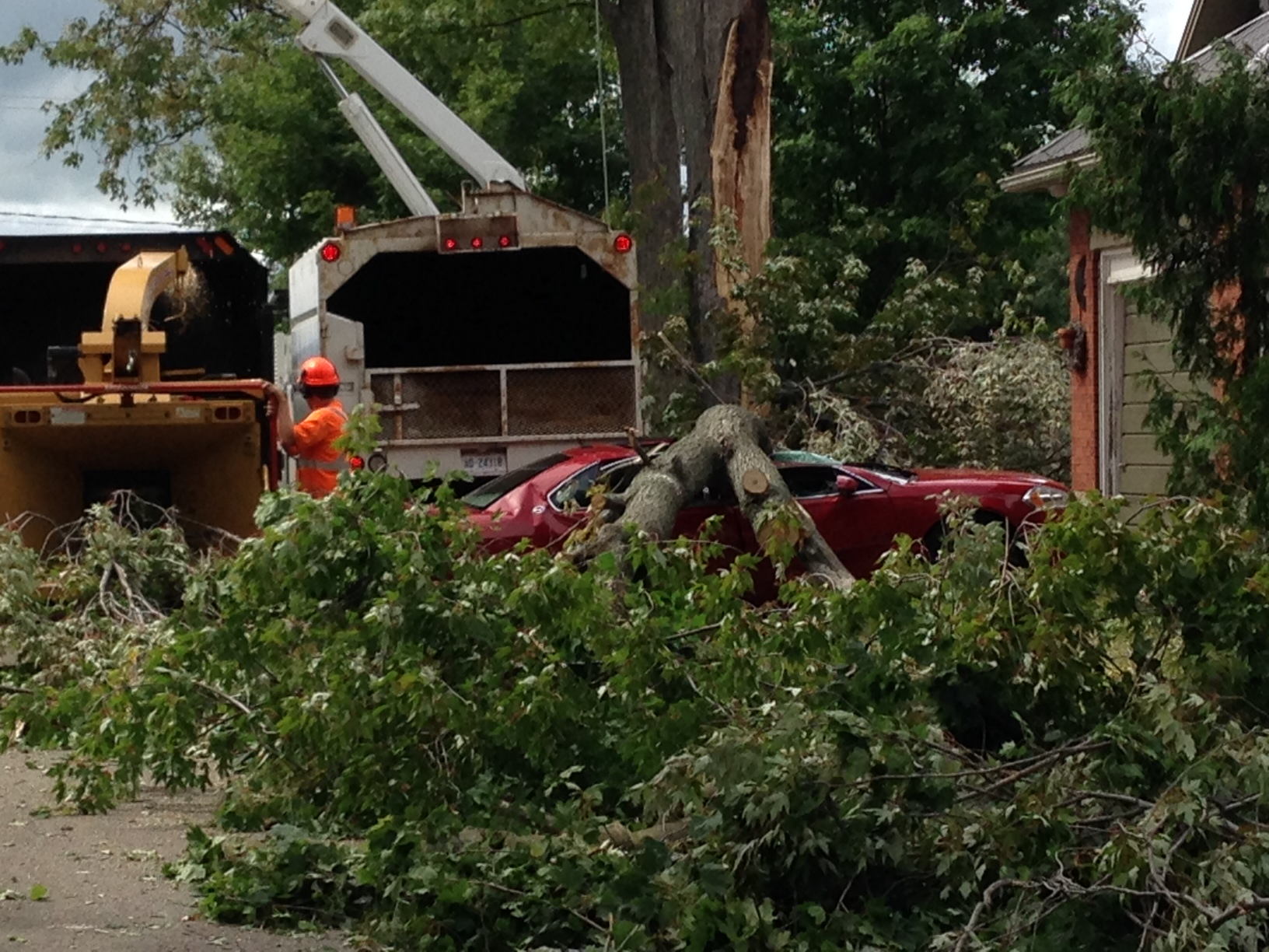 Damage on Isabella St. Wyoming in the aftermath of severe storms Sept 5, 2014 (photo by Sue Storr)