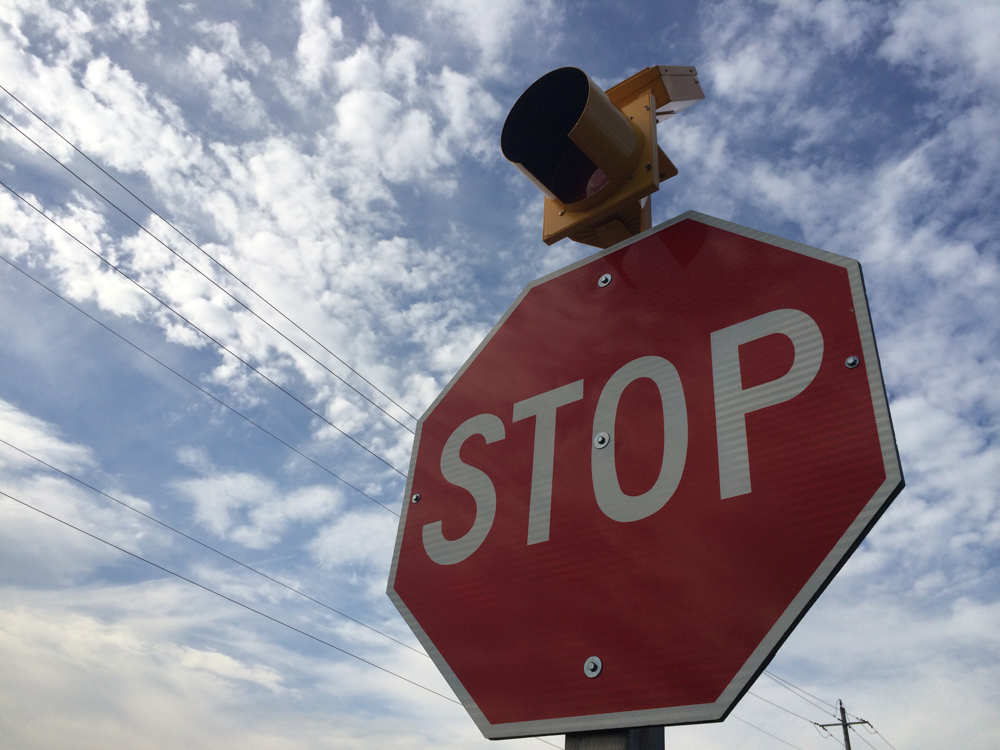 A large stop sign with a flashing red light on top stands on Rochester Townline at County Rd. 46 near Comber. Photo taken September 4, 2014. (Photo by Ricardo Veneza)