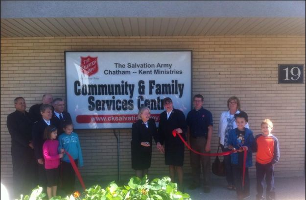 Officials cut the ribbon at the new Salvation Army facility located at 19 Raleigh St., Chatham. September 19, 2014. (Photo by Mike James)