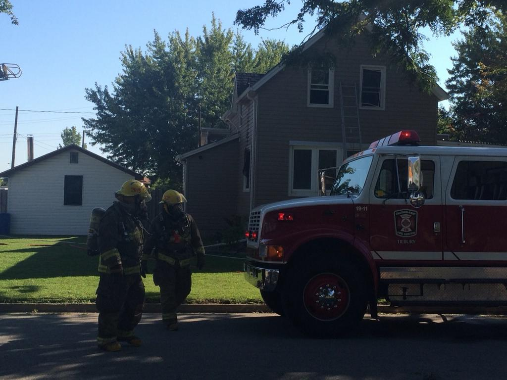 Fire crews at the scene of a house fire on James St. in Tilbury. Sept. 4, 2014. (Photo by Ricardo Veneza)