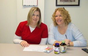 Pharmacy Technician Connie Newman (left) and Director of Pharmacy Nancy Kay (right) go over a patient's medication list.