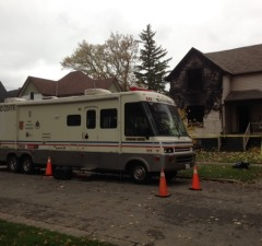 Officials investigate a suspicious fire of a home on Alfred St. October 21, 2014 (BlackburnNews.com photo by Jake Jeffrey)
