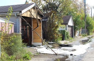 Damage to a garage on Gladstone Ave. after a suspicious fire, Oct. 24, 2014 (Photo by Maureen Revait)