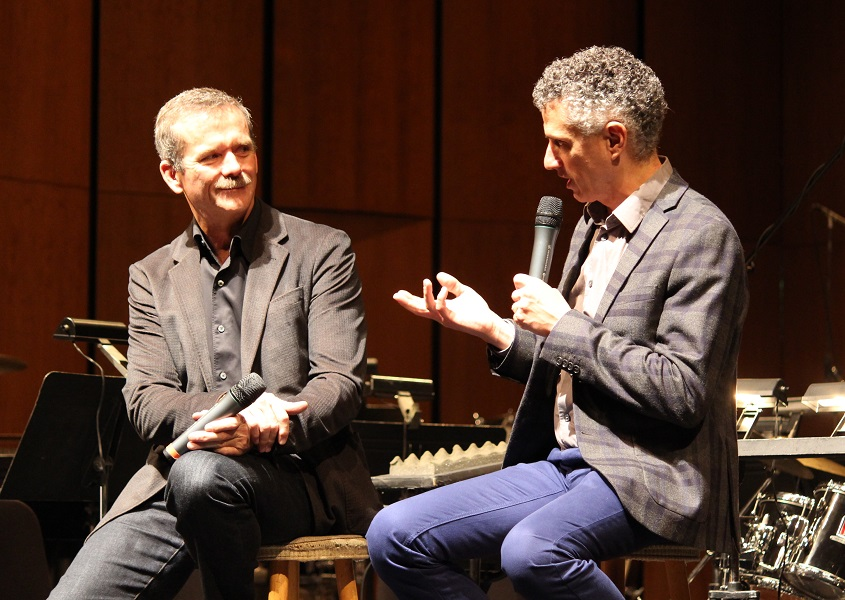 Colonel Chris Hadfield and Windsor Symphony Orchestra conductor Robert Franz discuss the premier of the first collection of songs written in space. (Photo by Maureen Revait)