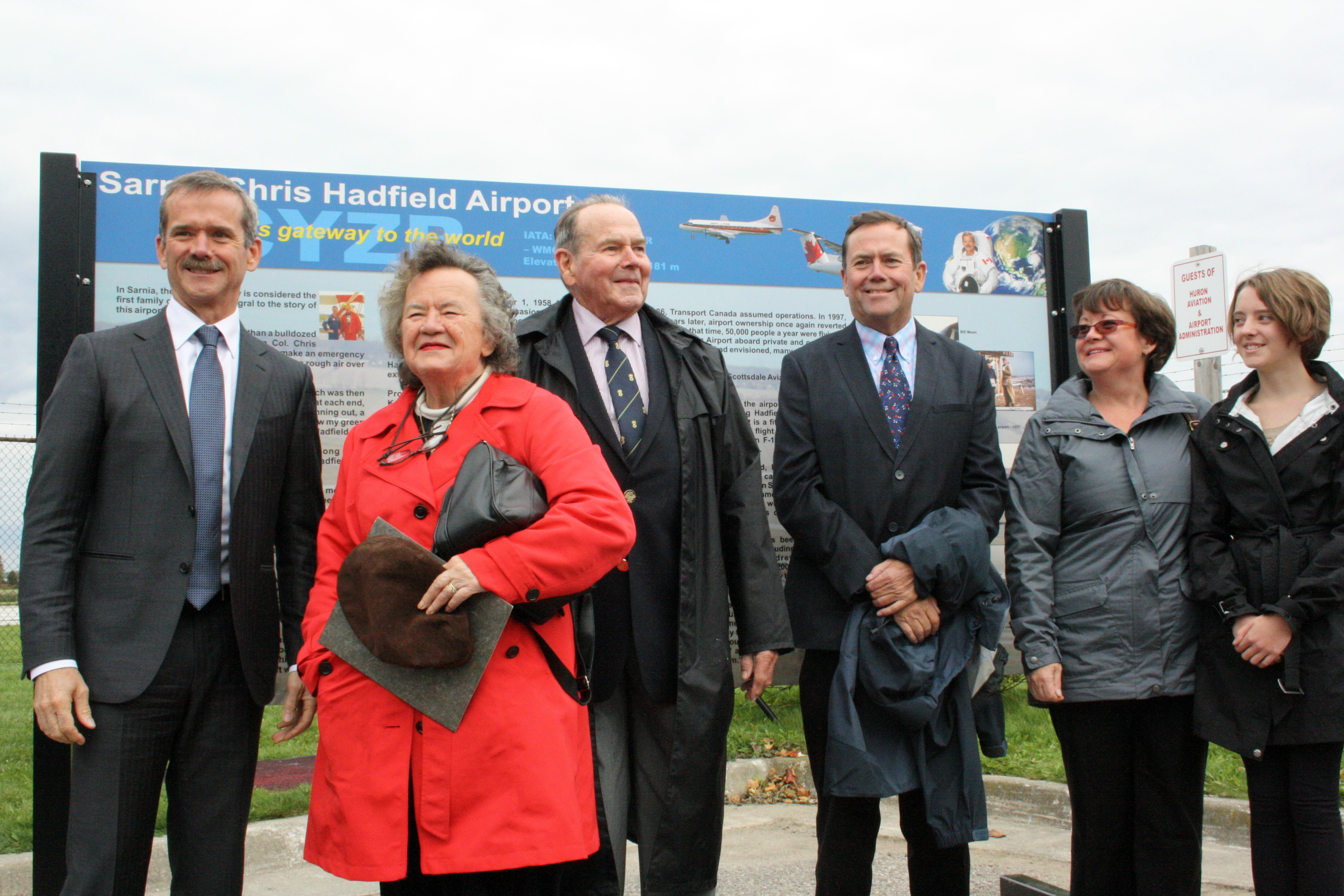 Chris Hadfield and members of his family including his parents attend the unveiling of interpretive signs at Sarnia's airport Oct. 5, 2014 (BlackburnNews.com photo by Dave Dentinger)