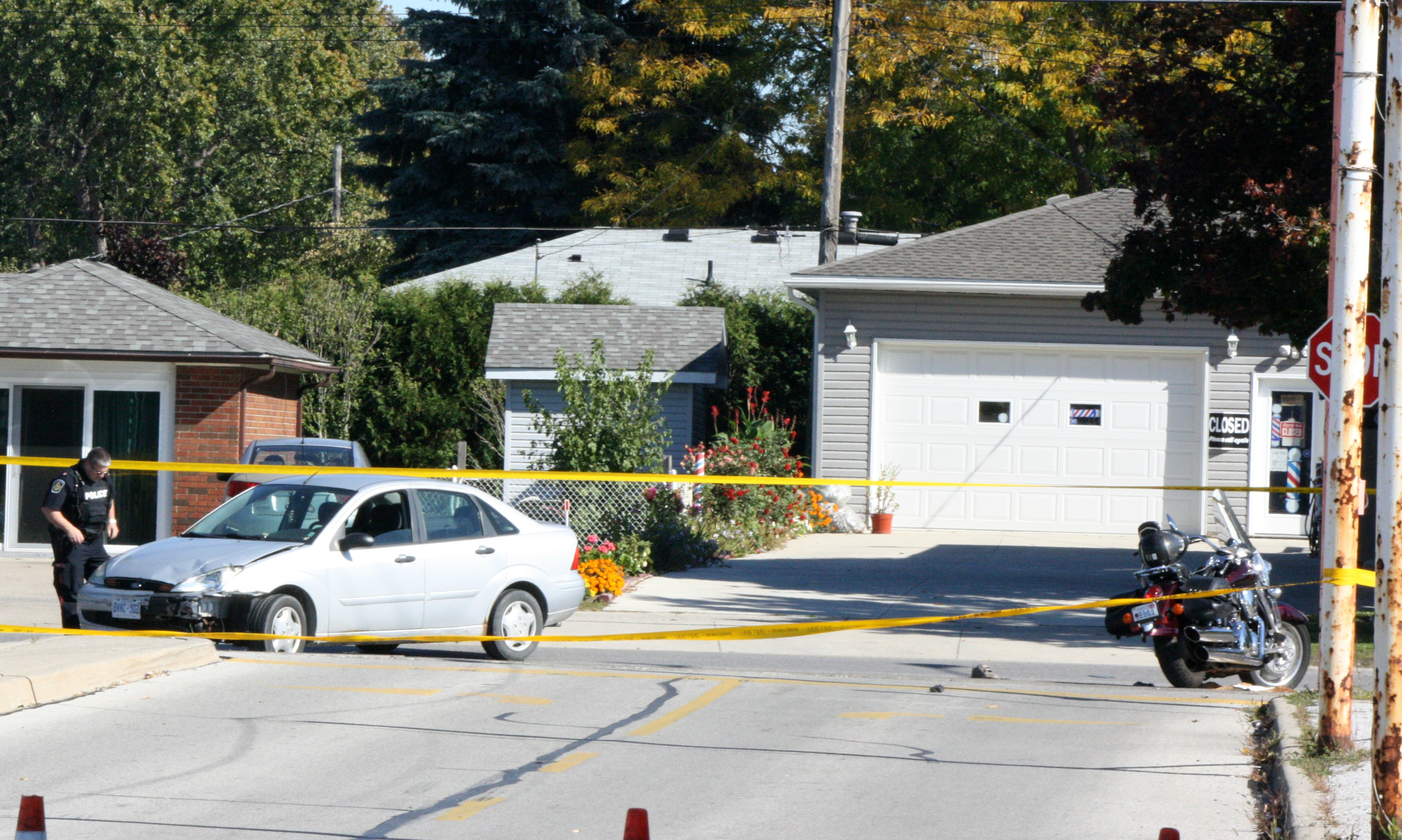City police investigate a crash involving a car and motorcycle Sun. Oct 12, 2014 (BlackburnNews.com photo by Dave Dentinger)