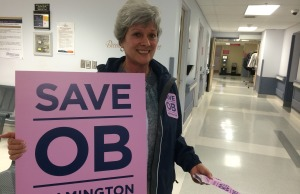 Linda Cornies greets people with a sign at the entrance of Leamington District Memorial Hospital on October 29, 2014. (Photo by Ricardo Veneza)