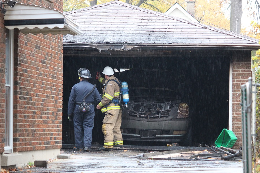 Windsor police and Windsor fire investigate suspicious blaze on Louis Ave. Oct. 31 2014. (Photo by Maureen Revait)