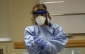Windsor Regional Hospital employee demonstrates how to put on personal protective equipment for infectious disease control. (Photo by Maureen Revait)