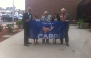 Mayor Randy Hope (far left) and CARP 49 Board Director Steve Brent (far right) joined staff and CARP members in the Seniors Day Flag Raising.