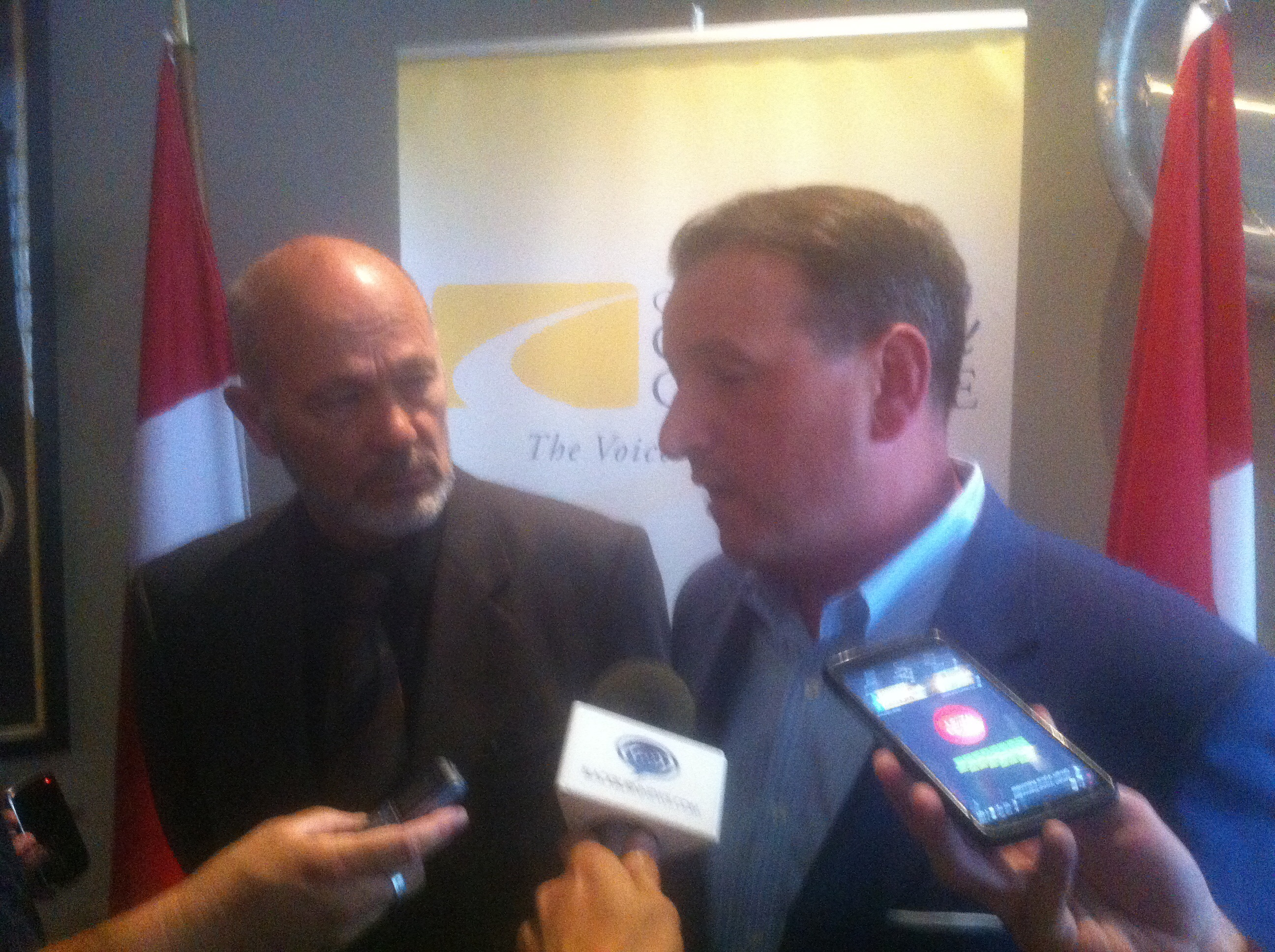 Minister of Natural Resources Greg Rickford (right) and Chatham-Kent-Essex MP Dave Van Kesteren (left) speaks with media following a luncheon in Chatham.
