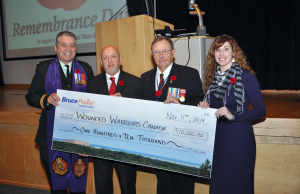 Philip Ralph, left, National Program Director for Wounded Warriors Canada, accepts a $110,000 cheque from Duncan Hawthorne, Bruce Power President and CEO, Harry Hall, Vice President, Supply Chain, and Crystal Shepherd, Personal Assistant to Harry Hall, during Bruce Power's Remembrance Day ceremony on Nov. 11. (Submitted Photo)